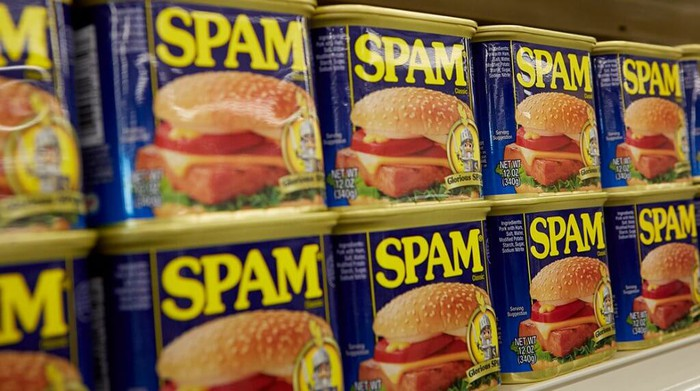 Many cans of Hormel Foods' Spam sit on a shelf.