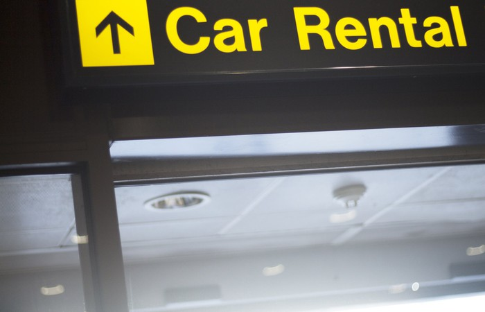 Car Rental sign pointing up