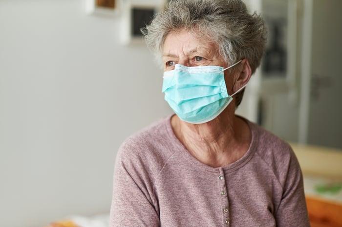 Older woman wearing mask