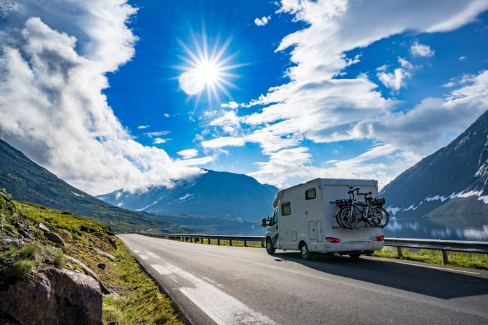 An RV camper on a mountain road.