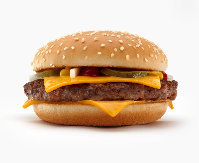 A McDonald's quarter pounder is shown sitting on a white background