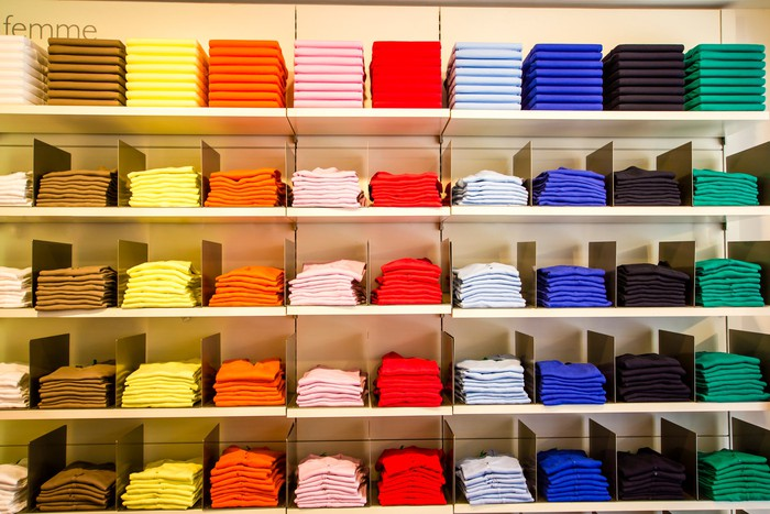 Apparel store's inventory of well-folded shirts on shelves