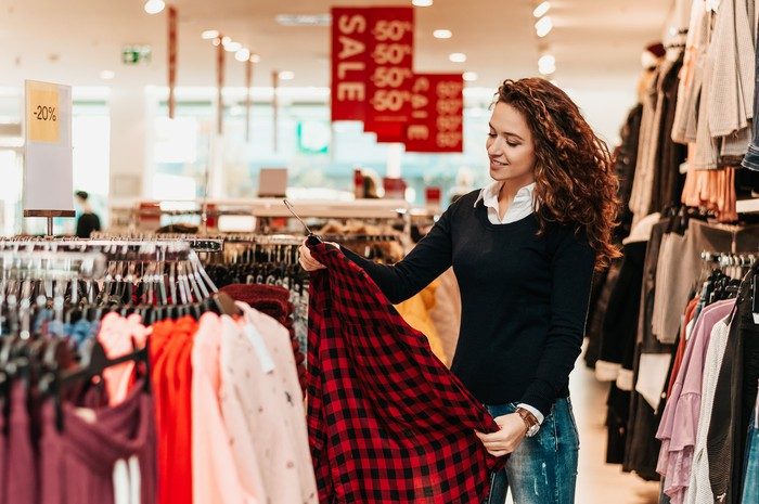Woman shopping at an apparel retailer