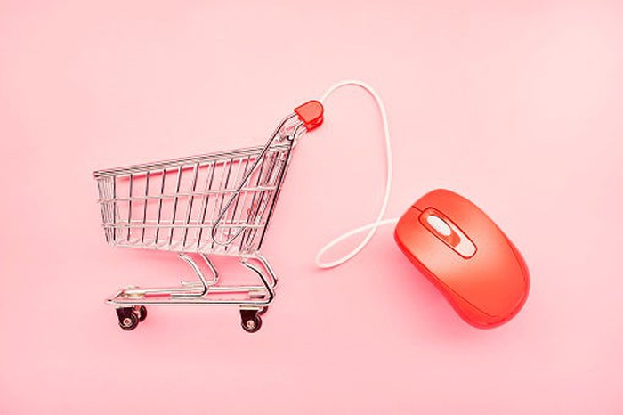 A shopping cart and a computer mouse