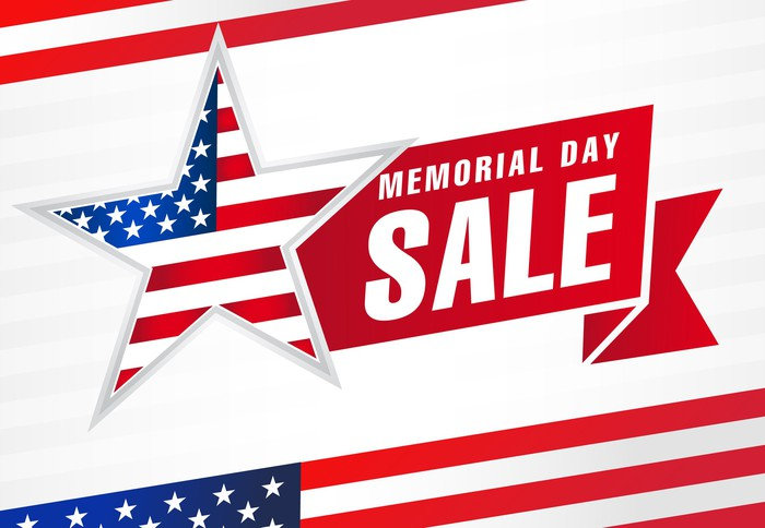 A sign draped in American flag colors saying Memorial Day Sale.