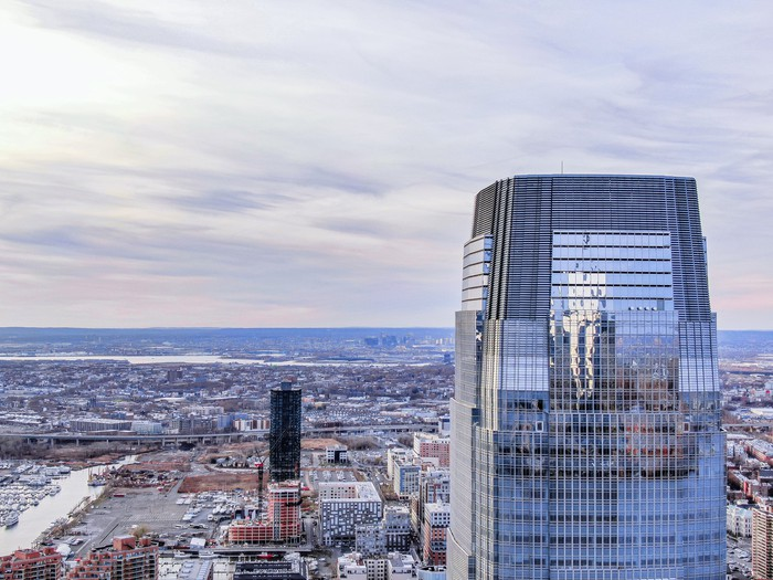 Goldman Sachs building towering over the Jersey City, NJ skyline
