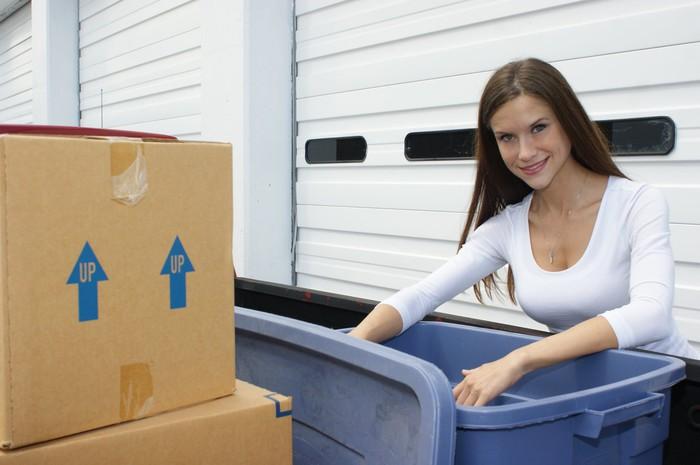 A woman looking through boxes at a self storage facility