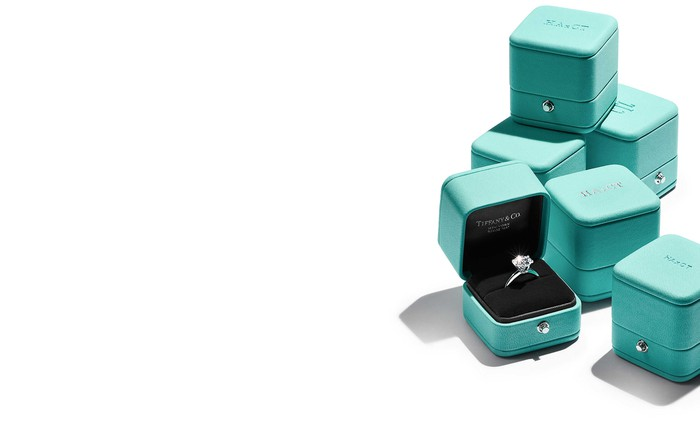 Tiffany blue jewelry boxes and a diamond ring.