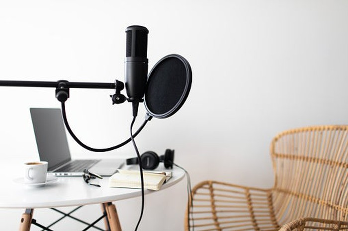 A microphone, a table and a chair