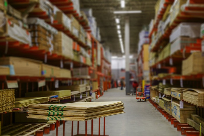 An aisle within the lumber section of a home improvement store.