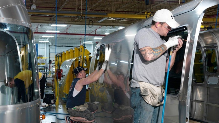 Assembly workers working on an Airstream vehicle.