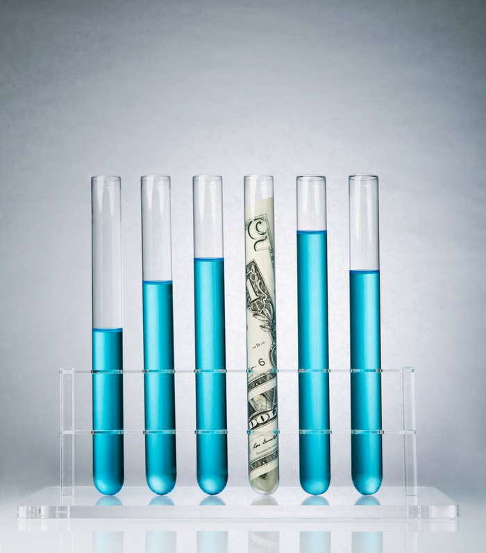 Rolled-up US paper banknote in a test tube rack
