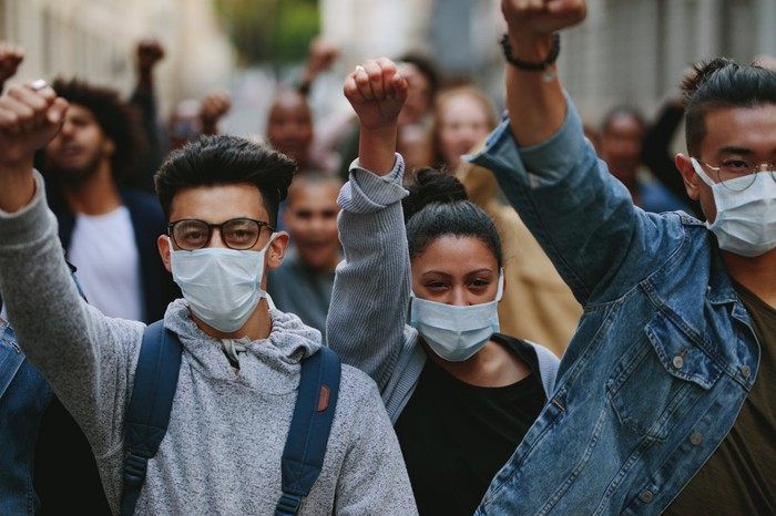 Group of protestors with face masks on.
