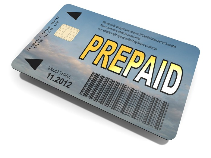 Closeup of a debt card with the word Prepaid stampedon it.