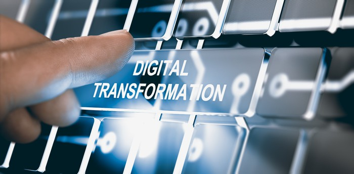 A person is about to push a button labeled digital transformation.