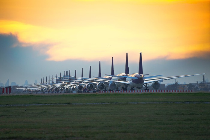 airplanes lined up at dusk