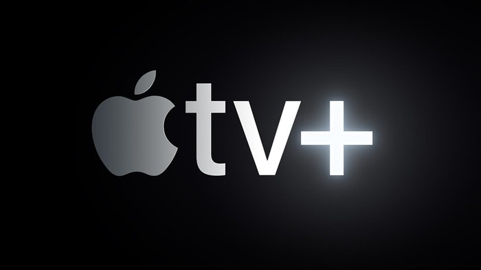 Apple TV+ logo in gray against a black background.