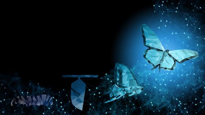 A digital caterpillar transforms into a butterfly.