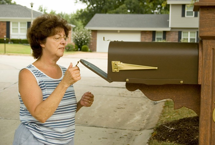 Woman opening mailbox