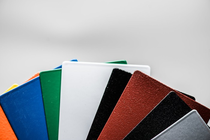 Metal rectangles of different colors fanned out like a hand of cards
