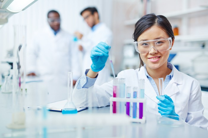 Laboratory worker looking at camera.
