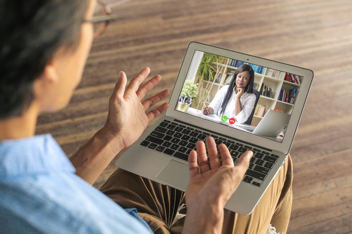 man having virtual therapy session