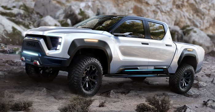 The Nikola Badger electric pick-up truck, displayed offroading over a rocky surface.