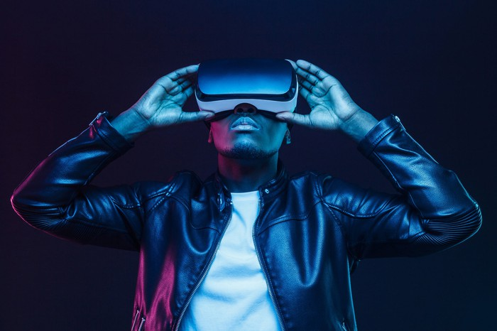 A man uses a VR headset.