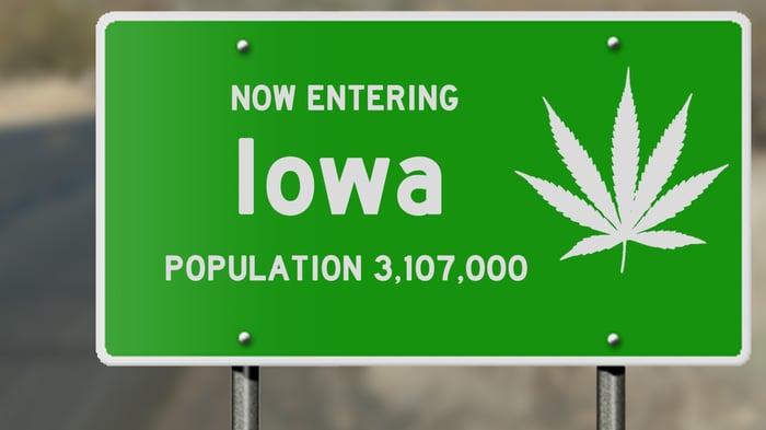Iowa road sign with marijuana leaf.