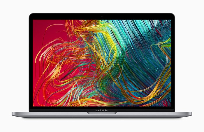 Apple Mac notebook open with swirls of color on the screen.