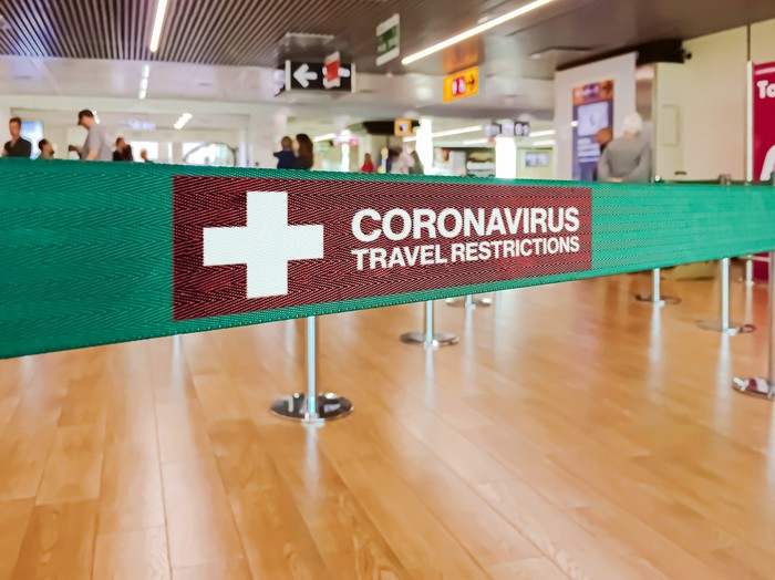 """A partition that says """"Coronavirus travel restrictions"""""""