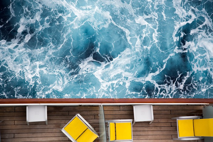 Rough water off the side of a cruise ship.