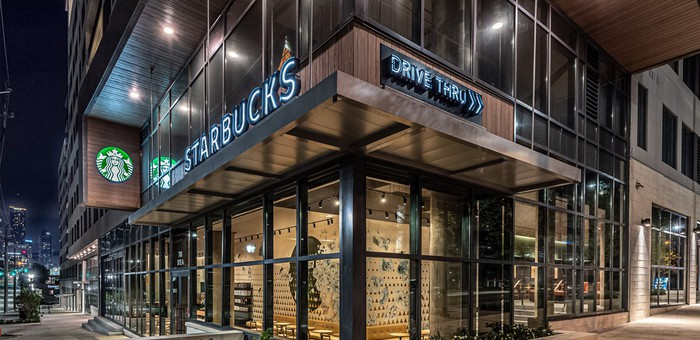 A Starbucks small-format store with a sign saying Drive Thru