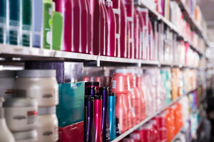 A store shelf with various hair care products.