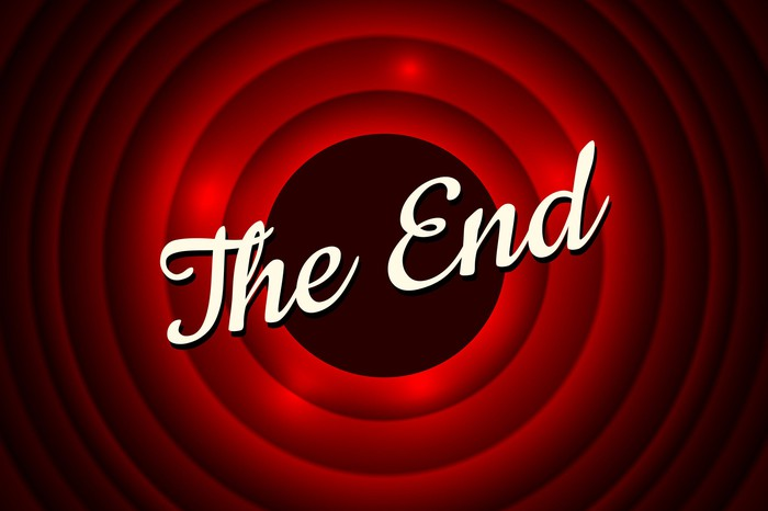"""An old movie ending title card with text that says """"The End"""" over a background of concentric red circles."""