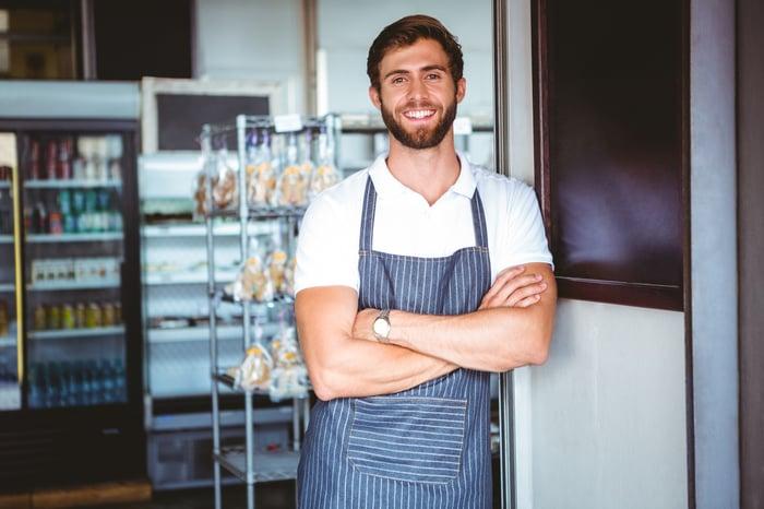 Smiling man wearing apron