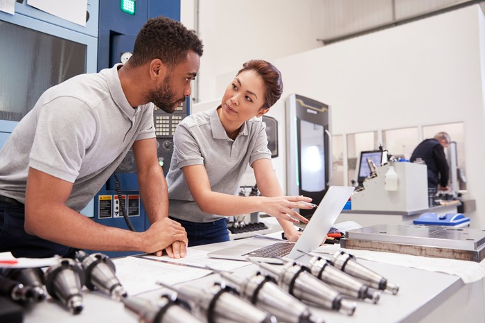 Factory engineers utilizing data center technology for machines.
