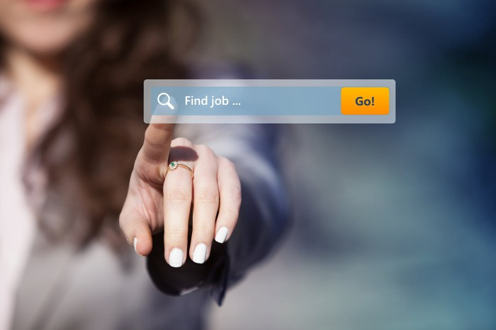 "Woman using a search engine reading ""Find job."""