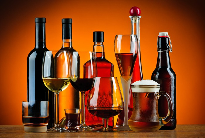 Bottles and glasses of beer, wine, and spirits.