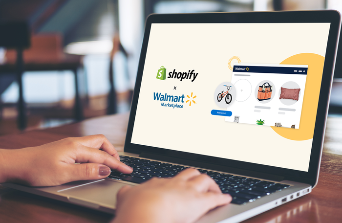 Hands on a laptop displaying Shopify and Walmart's collaboration.