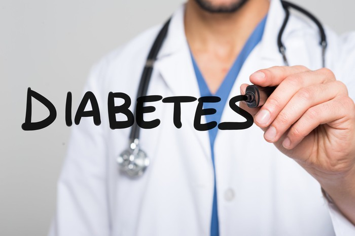 Doctor writing diabetes