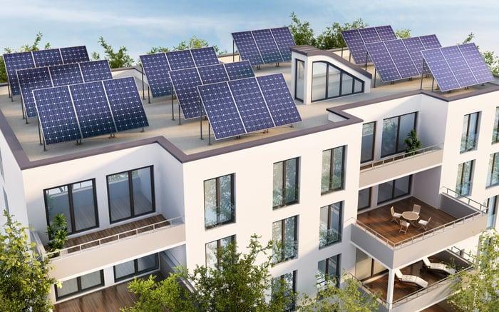 Solar panels atop a multi-unit apartment building