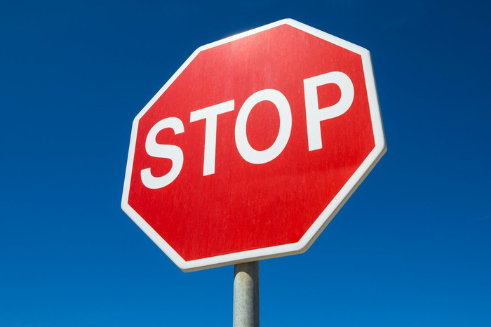 Regular, eight-sided stop sign with white letters on red background