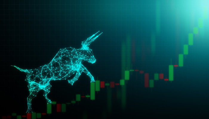 A digital bull is climbing an upwardly sloping stock chart.
