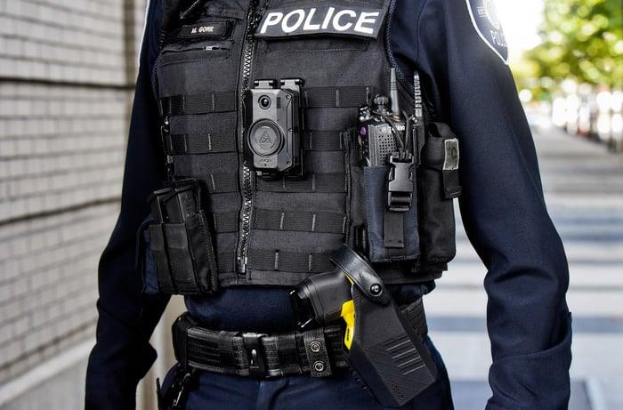 Police officer with a holstered Taser