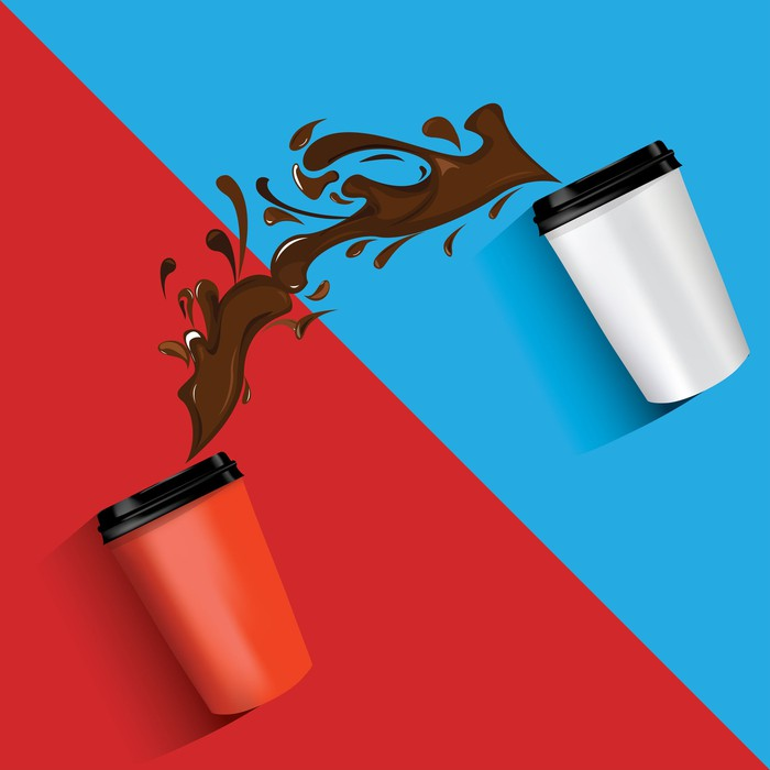 Coffee spilling on a blue and red background.