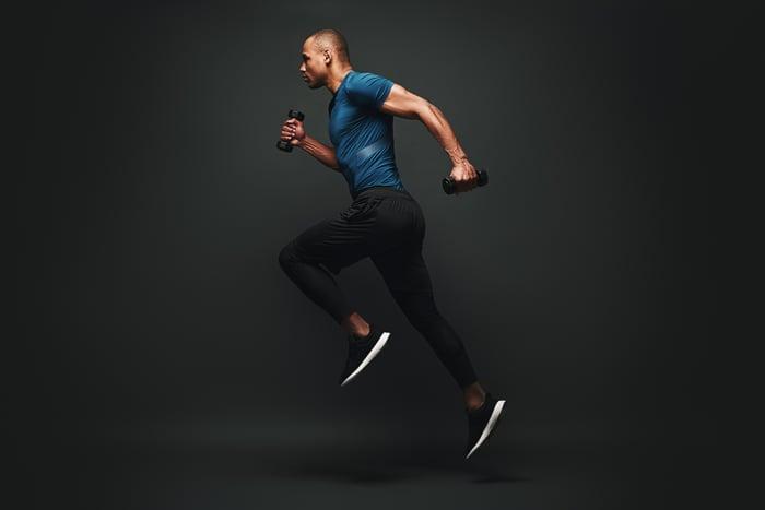 man wearing athletic gear posing in running formation