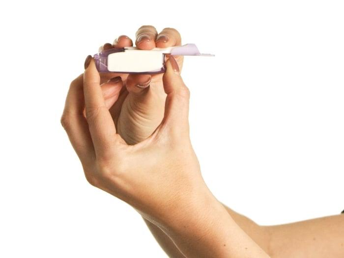 Hands holding Afrezza inhaler
