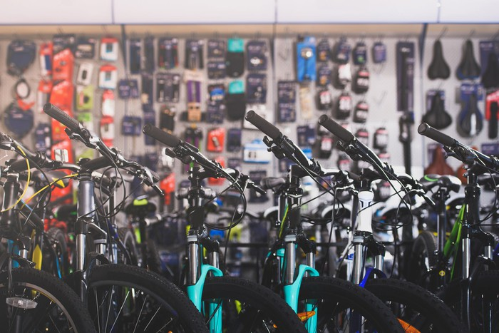 A line of bicycles in a sporting goods store.