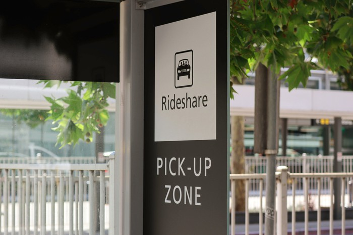 Sign showing the rideshare pick-up zone at a public transit stop.